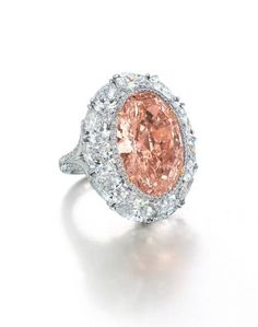 Rare 12.85ct Oval-shaped Fancy Intense Orangy Pink Diamond and Diamond Ring Centering upon an oval-shaped fancy intense orangy pink diamond weighing approximately 12.85ct, the piece is set fringed by a brilliant-cut diamond border and pear-shaped diamond surround. Set in platinum and 18k rose gold. High estimate: US$6.25 million. Photo courtesy of Christie's