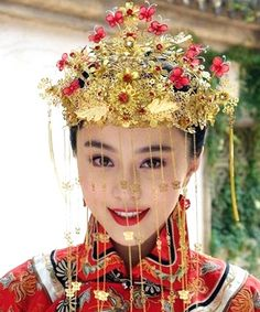 In China, it's not white but red -- symbolizing good fortune -- that many brides wear on their big day. That gorgeous gold headdress can't h...