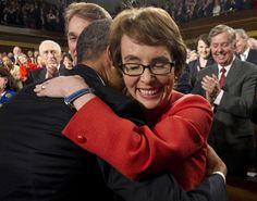 The 24 Most Inspiring Photos of 2012 // U.S. President Barack Obama embraces U.S. Rep. Gabrielle Giffords .