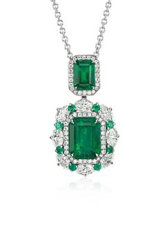 Exquisite elegance, this gemstone and diamond pendant showcases two vibrant green emeralds totaling 4.50 carats accented by sparkling marquise and round brilliant diamonds for a one-of-a-kind look.