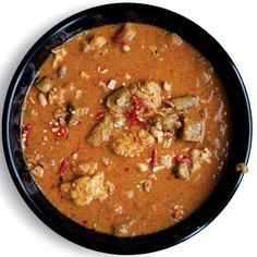 The list of ingredients in a West African Peanut Stew often extends to okra, tomatoes, hot chiles, and other bright foils for the stew's intense richness, but it's the indispensable peanut that gives this dish its essential earthy character. Soup Recipes, Chicken Recipes, Cooking Recipes, Okra Recipes, Easy Recipes, Recipies, Chilli Recipes, Korma, Biryani