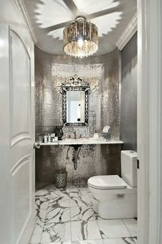 Glamour bathroom! Oh my! Lovely! Feel living in the luxurious Hollywood regency @Jean Duge the light fixture.
