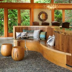 Eclectic kitchen in Vancouver...beautiful hand hewn wood curved kitchen island, with opposite banquette and love the pebble flooring...so natural!
