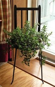 Wrought Iron Adirondack Chair Plant Stand by Village Wrought Iron - The Charming Home Store  This is another product we LOVE by Village Wrought Iron.  It can be used indoors or out.