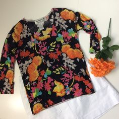 "Pretty Vivid Floral Top The colors in this pretty floral print are perfect for fall Measurements, not stretched, lying flat: Bust 18""; Sleeve about 16""; length shoulder to hem 21""  EUC, no damage or problems  smoke free home  Joseph A. Tops"