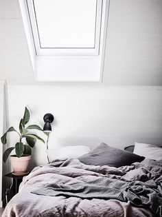 Skylight, rumpled bed.