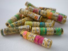 paper beads with thread - could be made with ribbon or embroidery thread and with paper letters that spell a word