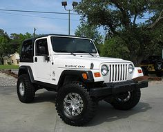 White Jeep Rubicon ... Me and my dad were looking at jeeps yesterday . Can't beleive I'm old enough to get a car .. So surreal