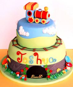 ....for 5 yr. old Joshua. Bottom cake, is a chocolate mud cake with chocolate ganache mousselline buttercream. Top cake,is a white chocolate mud cake with vanilla mousselline buttercream. I know the train should have been placed on the railway track but I made it much too big and my kids had a good laugh as it was above the clouds. Explore #2