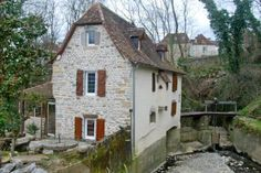 Fully-restored water mill in Aquitaine, France.