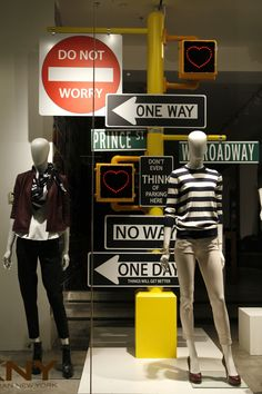 The open back of the store's window shows dimly partially into the store. However, its focal point dominance both the clothes and prop.