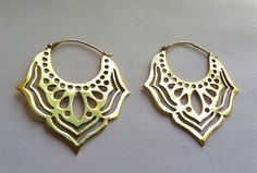 Beautiful handmade lotus hoop earrings. Made from brass (copper and zinc) Nickel free. Length - 6cm Width - 5cm Please contact me with any questions