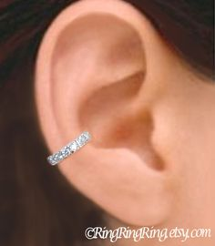I WANT AN EAR CUFF!!! This one isCZ silver ear cuff - 925 Sterling Band with Cubic Zirconia earcuff for men and women 080112. $45.00, via Etsy.