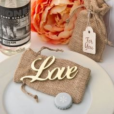 Shabby Chic Gold Love Bottle Opener Favors (FashionCraft 4242) | Buy at Wedding Favors Unlimited (https://www.weddingfavorsunlimited.com/shabby_chic_gold_love_bottle_opener_favors.html).