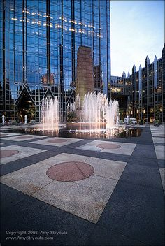 Water play fountain downtown Pittsburgh by PPG.  We used to go here in college and play in the fountains.  So much fun :)