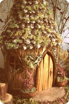 Fairy House - pine cones for shingles, willow for door and window frame...