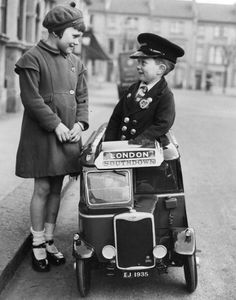 Five year old Ernest Johnstone in his toy bus which he is going to pedal to London from Hove in Sussex 1935