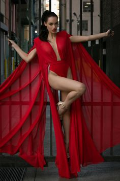 Red oversized kimono sleeve bodysuit with sheer nude neck & strong shoulders.- Michael Costello US Size Chart- Made true to size- When choosing height, include the inches of your heels- If you select custom, one of our representatives will contact you for size information- Dry clean only