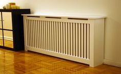 Radiator covers - Bob Vila's Tip of the Day: Keep clean and free of dust, to improve efficiency. When ordering a custom cover, make sure that it's properly designed. There should be a grille or slats on the front to direct heat into the room and gaps at the top and bottom to encourage air flow. Reflective material on the inside back of the radiator cover will help reflect heat into the room.