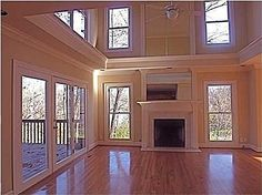 This is how you do the 2 story open room. You put a wrap-around ledge between the upper and lower windows.