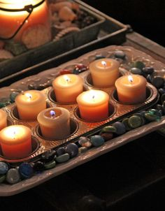 Make good use of those old muffin tins & feel a little safer while burning votives. *You could also use a bread tin for bigger candles. : )