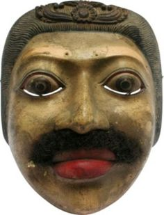 """Vintage Topeng Mask (Indonesia) As described by Antonio Martins:    Vintage Topeng mask worn by a performer doing the """"Old Man"""" dance. This mask was carved from pule wood, preferred by Balinese mask makers for its lightweight properties and subtle color. It is decorated with acrylic paints and eyebrows and facial hair made from horsehair. It is finely crafted and in very good condition.  $85"""