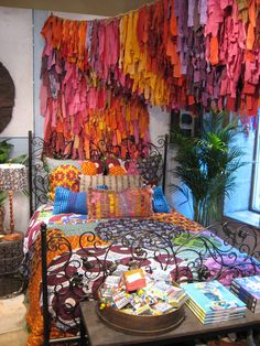 anthropologie display of multicolored quilts, pillows and hand-dyed fabric by trilby nelson