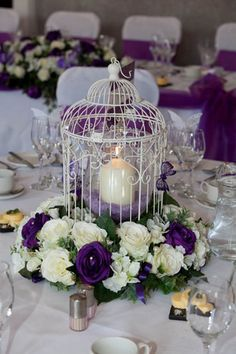 Wedding centre pieces, bird cage with butterflies and cream and purple flowers, | eBay