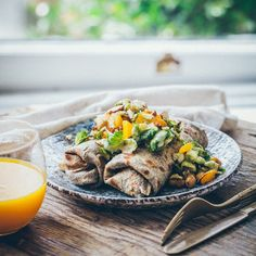 buckwheat crepes stuffed with fried broussell sprouts with pumpkin, chickpeas and garam masala