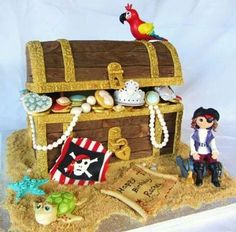 This large Treasure Chest cake sits on a 16 inch square board and was made for Rachel's birthday. She is a huge fan of Pirates of the Caribbean and was having a wonderful treasure hunt organised by her Mum & Dad for her birthday. Treasure Chest Cake, Pirate Treasure Chest, Fancy Cakes, Cute Cakes, Pirate Birthday Cake, Pirate Cakes, Facebook Cake, 10th Birthday Parties, 5th Birthday
