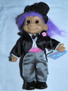 Russ Lucky Travis 8 Inch Groom Tuxedo Prom Troll (Purple Hair) by Russ Berrie, http://www.amazon.com/dp/B008SA20KC/ref=cm_sw_r_pi_dp_o3vArb0J9BT94