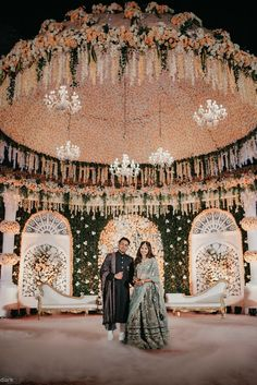 Looking for Royal stage decor idea? Browse of latest bridal photos, lehenga & jewelry designs, decor ideas, etc. Reception Stage Decor, Wedding Stage Backdrop, Wedding Stage Design, Wedding Entrance, Wedding Designs, Engagement Stage Decoration, Wedding Hall Decorations, Desi Wedding Decor, Luxury Wedding Decor