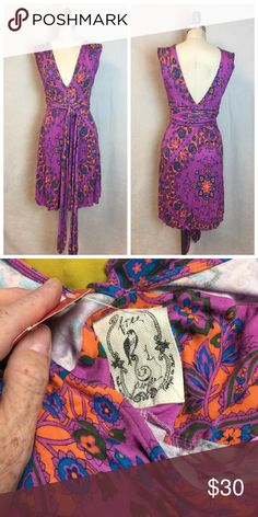"Free People Dress Fits size 2/4. VGUC. Super low cut. Really beautiful bust 32"" Waist 27"" Free People Dresses Mini"
