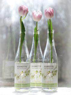 tulips in wine bottles