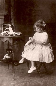 Girl with her dolls