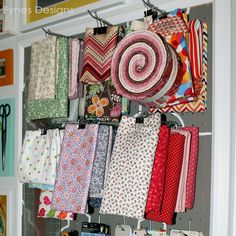 Craft Room Organizing Ideas: store fabric with binder clips for easy access, so I remember I have it!