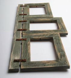 "This collage frame is made from (3) 5x7-- 2"" barnwood frames connected to a barnwood header with rusty brackets. It hangs 2 5x7 rustic frames horizontal and 1 5x7 vertical. This frame measures approxi"