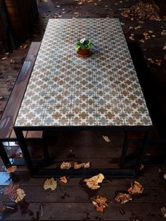 Custom steel table with tiled top and spotted gum bench seat