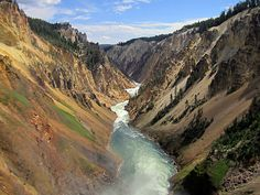 The beautiful and dramatically colored Grand Canyon of the Yellowstone at Yellowstone National Park in Wyoming. The colors on the canyon walls are so vivid and stunning and the river in between combines for an amazing landscape. Prints starting at $22.
