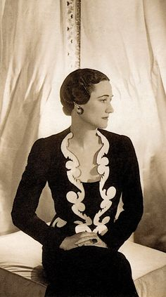 Stunning dramatic portrait of Mrs. Wallis Simpson at the Château de Candé in France, June 2, 1937. Silver print (detail) photograph by CECIL BEATON. Mrs. Simpson wears a Schiaparelli dress & jacket in carbon blue silk jersey embroidered with gilded baroque scrolls. On her left hand her Cartier engagement ring. (before alteration in 1958) The Duke & Duchess of Windsor Sotheby's Catalog 1997 (please follow minkshmink on pinterest) #wallissimpson #cecilbeaton #schiaparelli