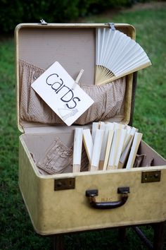 i like the idea of using a suitcase as a cardholder AND using the fans for an outdoor summer wedding