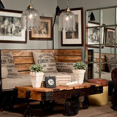 An industrial chic sitting area set off with beautiful #customframed sepia toned and black & white photographs.  Great #art choice!