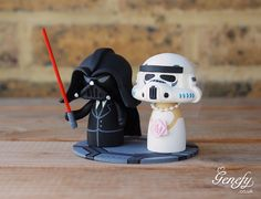 Darth Vader groom and Stormtrooper bride wedding cake topper by Genefy Playground.  https://www.facebook.com/genefyplayground