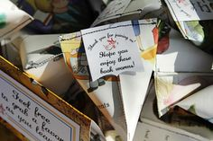 "Pockets made out of recycled book pages and used to hold ""book worm"" favors!"