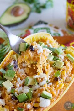 This Southwestern inspired stuffed spaghetti squash is a great way to change things up for a meatless meal during the week. It's easy and fast and good for you!