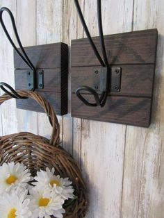 These Vintage Style Black Coat Hooks on a Rustic Wood Backer would go beautifully anywhere in your home. A perfect addition to your other farmhouse decor, either in your entryway for coats and bags or in a bathroom as a towel hook.•All coat hooks come with keyhole hangers. •Each Coat Hook is made from Rough Sawn lumber and goes through different processes to reveal the rough sawn marks and give it a beautiful rustic look. It is then finished with a satin clear coat over it to preserve the… Decorative Coat Hooks, Rustic Coat Hooks, Vintage Coat Hooks, Entryway Coat Hooks, Coat Hooks On Wall, Wall Mounted Coat Rack, Bathroom Towel Hooks, Bathroom Shelves, Bathroom Cabinets