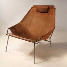 Erik Ole Jørgensen; #J361 Chromed Metal, Rosewood and Suede Easy Chair for Bovirke, 1954.