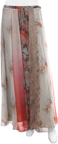 Full chiffon circle skirt by Haute Hippie. Vertical panels create a slimming patchwork of two florals, one ombre, and one snakeskin print.