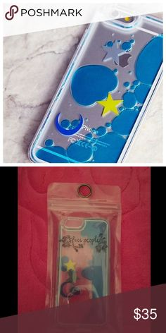 Free people phone case Brand new in packaging free people phone case, floating stars /moon with blue liquid. will fit iPhone 6/ iPhone 6s. No trades or holds, price is firm! Sold out in stores! Free People Accessories Phone Cases