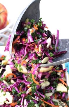 I love the flavors in this beautiful Apple, Kale and Cabbage Salad.  Crunchy carrots, raw kale and red cabbage mixed alongside sweet apples, slivered almonds and sweet dried blueberries, then topped with a sweet and tangy apple cider vinaigrette.